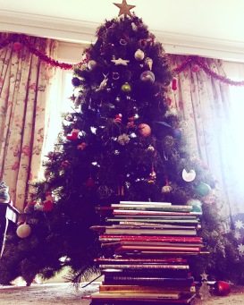 Reading Christmas Books Under the Tree